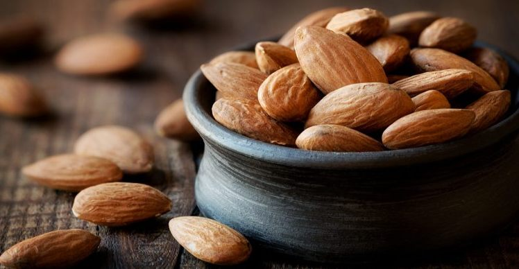 full bowl of almonds / almonds can promote sleep