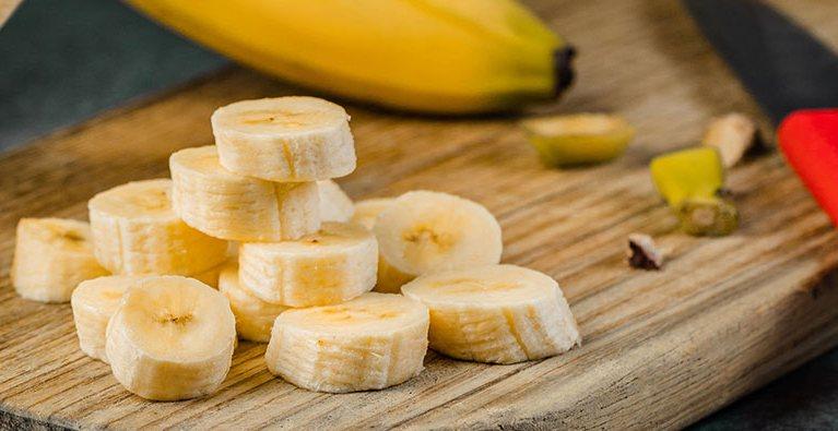 Sliced Bananas on the wood / bananas cause headaches