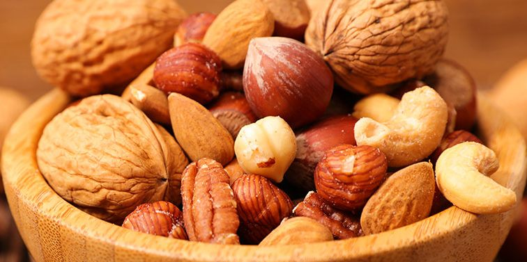 a cup of mixed nuts / nuts can give you heartburn